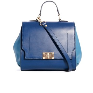 This purse exemplifies the top handle trend. A feminine take on the doctor  bag 3c4ef941cfabd