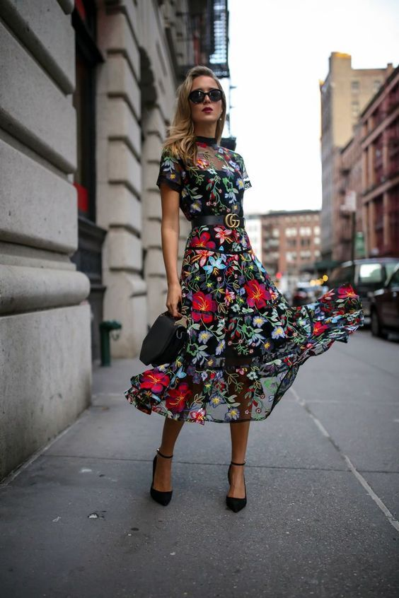 11-a-moody-floral-midi-dress-with-a-sheer-bodice-and-skirt-short-sleeves-and-black-shoes-and-a-bag (1)