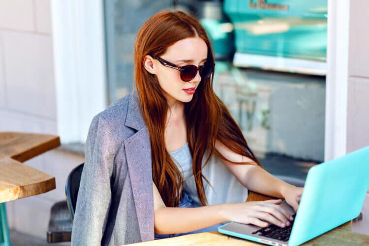 girl-typing-laptop-750x500